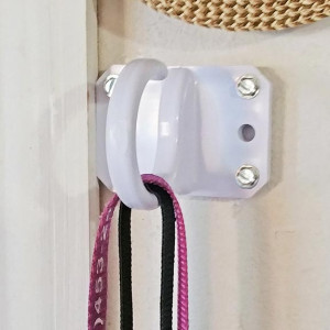 Storage hook hard mounted to wall in use on an interior wall